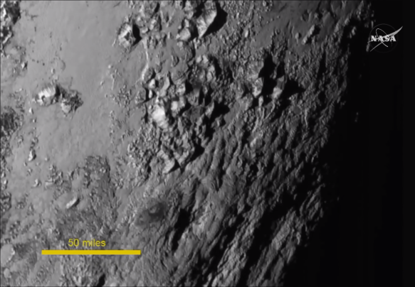 Pluto's Surface Mountains, NASA July 2015, Creative Commons.